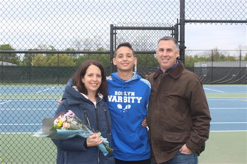 Senior tennis player and family