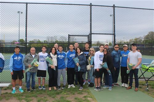 Senior tennis players and family
