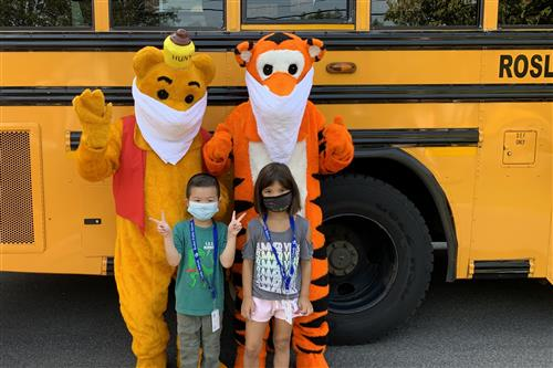 Winnie, Tigger, and students