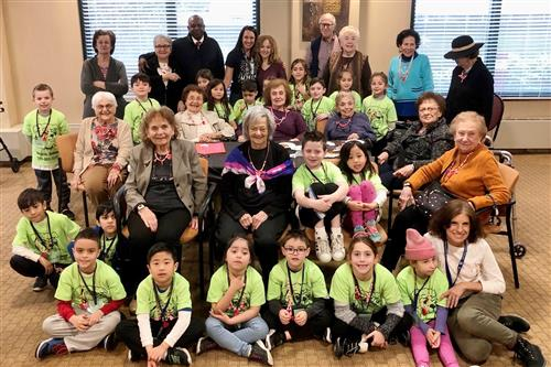 Heights students visit with students at Atria assisted living